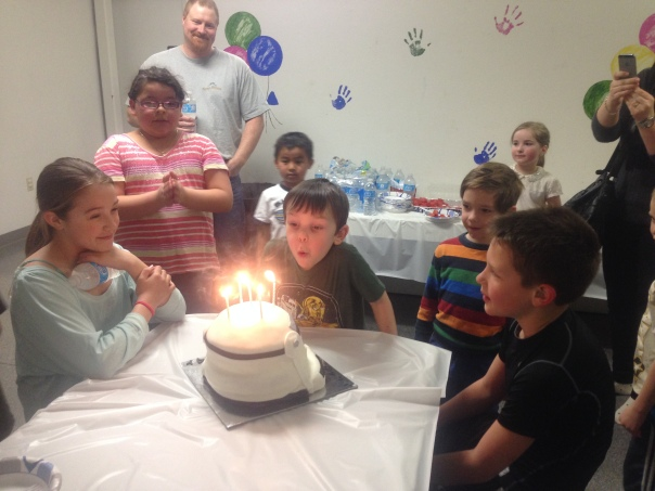 Birthday at Bouncin' Bears.  Yes, the cake is a Storm Trooper head.